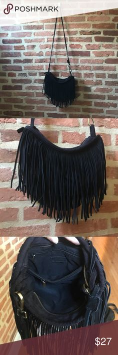 Black fringe cross body bag Black fringe cross body purse! Material is suede. There a two inside zipper pocket. New without tags. Urban Outfitters Bags Crossbody Bags
