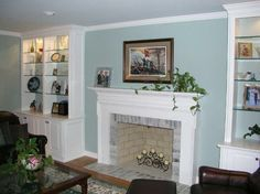 (replace glass shelves with wood shelves) Built-in Fireplace Cabinetry and Mantle Fireplace Built Ins, Fireplace Mantle, Fireplace Ideas, Wood Shelves, Glass Shelves, Wall Colors, House Colors, Family Room, New Homes