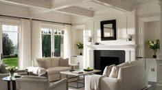 Like the light weight feel of drapery The coffered ceiling and the fireplace surround is super. The monochromatic colour scheme is not so pleasant.