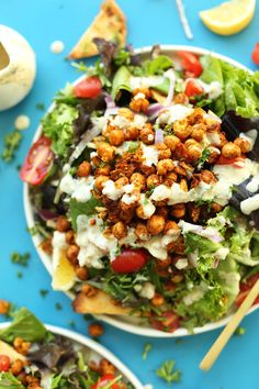 All of the flavor of a chickpea shawarma sandwich in a salad! Mediterranean-spiced chickpeas fresh salad and a 3-ingredient Garlic Dill dressing! A flavorful filling plant-based meal.