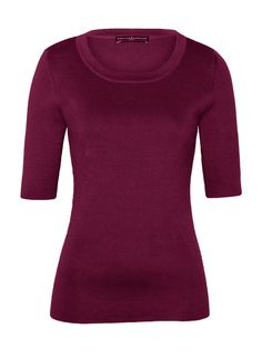 A dressier t-shirt/knit top could be dressed up or down. Peruvian Connection | A polished, minimalist basic, Elemental Top has a round neck and elbow-length sleeves.