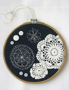 doilies and buttons on a hoop as art