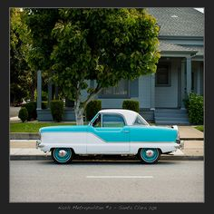 Nash Metropolitan. I want one so bad!! Painted just like Wesley's 55