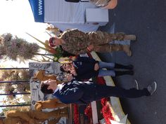 Reunited military family at Natural balance rose parade float. Post parade interview