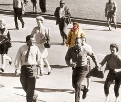 During President John F. Kennedy's 1963 assassination, a woman can be seen in various footage and photographs who is taken some photos for herself. While others around her were ducking for cover, she was simply taking photos. She was never found and her photos were never recovered. Read more at http://americanlivewire.com/2014-12-31-10-mysterious-photos-cant-explained-10/Photo courtesy of Imgur.