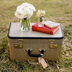 picnic case. I love the idea of using an old suitcase for a picnic basket, then using as a table.