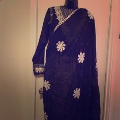 Beautiful Black and White Indian Sari This is a reposh. Unfortunately I don't know how to wear a sari :( Probably should have thought about that before I bought it haha. Good condition! Still in the box the person originally sent to me. Dresses