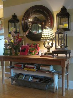 Entry.. love the lanterns on the side of the mirror, the lamp shade, and bench under table.