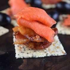 @that_paleo_guy is serving up the perfect Friday night appetizer with these @jilzcrackerz topped with bacon and our new Smoked Sockeye Salmon! These tasty bites would make a great addition to your holiday spread! .  Head to our website to order Smoked Salmon for your holiday party! www.sizzlefish.com  __________________________________