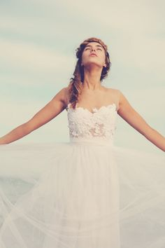 Love the half sheer/ half lace bodice. Looks strapless but isn't.   Magical white lace wedding dress with soft tulle by Graceloveslace, $999.00