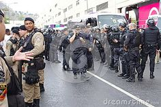 Brazilian military forces protecting Rio2016 Olympic torch relay of the streets Rio`s rundown neighborhood Gamboa. Photo taken on Aug 3, 2016