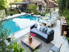 The captain of the Cheerios, Dianna Agron, did all right for herself with this gated compound. The gracious pool area is rivaled by a spacious living room topped by a high, arched ceiling with exposed beams.
