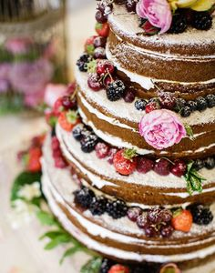 """4. Thiscake from this Laid Back Irish Wedding is so amazing because it is a """"naked cake"""" but still topped with so many fresh goodies and florals."""