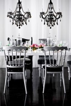 Black and white party theme. Hiring of ceiling hanging Candelabras