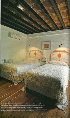 Orange painted wrought iron beds