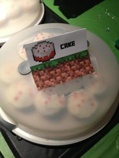Minecraft Birthday Party Cake (cupcakes with white frosting and red frosting dots)