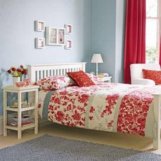Pale blue and red bedroom.....