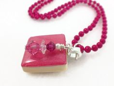 Vibrant rose scrabble tile pendant with a rose Swarovski beaded charm; all hanging from a rose ball chain.  Find this and more at www.wiredboutique.etsy.com  $23.00