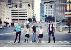 super cool family shot.  Lights are green and everything.  Hope no one got run over! haha!  milliehollomanblog.com