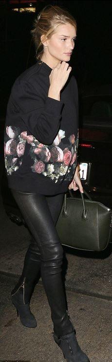 Who made  Rosie Huntington-Whiteley's black leather pants, green handbag, and rose print sweatshirt?