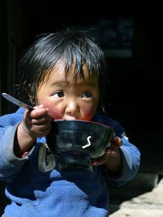This is a good caption because it tells us background of the kid and what he is doing-Amiah Ciampi-noodle time Photo by Dan Walton -- National Geographic Your Shot A young Sherpa boy enjoys his breakfast