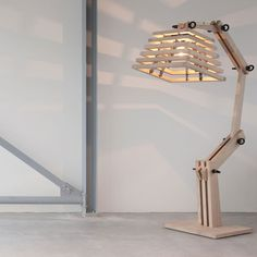 This wooden floor lamp is really interesting on many levels.  Really does have a tree feel but industrial at the same time.