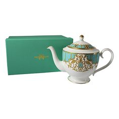 Gorgeous teapot with Tiffany coloring...WANT...