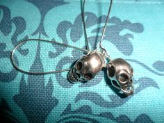 'Pair of skull earrings' is going up for auction at 12pm Tue, Jul 24 with a starting bid of $3.