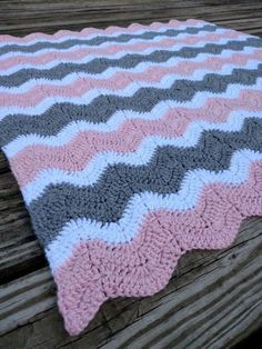 Crochet Pink, Gray, and White Ripple Baby Afghan! Want another size or color? Please contact me! I love special orders! Turnaround times as short as one week! Makes a great baby shower gift! Hand-made baby blanket in light spring tones. Double crocheted chevron stripes in light rose pink, heather grey, and bright white. Blanket measures 30 inches by 34 inches and is the perfect big size for car seats, tummy time on the floor, strollers, photo props, and bassinets. Blanket is made from a…