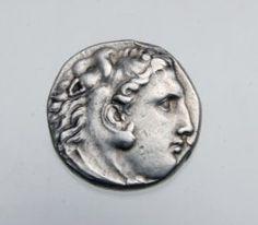Greek Silver Alexander the Great Silver Tetradrachm coin with lion-head headdress. 336 - 323 BCE