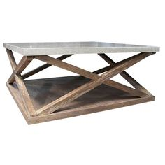 Marble-topped coffee table with open x-shaped sides. Product: Coffee tableConstruction Material: Veneers and ma...