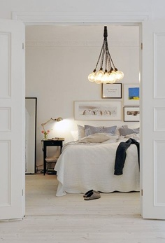 Nice light bedroom...reminds me of Lee's Edison chandelier!