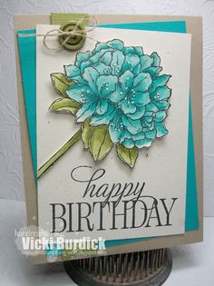 Best Thoughts hostess set in black stazon on naturals very vanilla card stock colored with Aqua Painter and ink pads. Fussy cut it out to add to card. The base is Crumb Cake and the next layer is Bermuda Bay and then a layer of the Naturals card stock. Sentiment from the Happy Birthday Everyone hostess set in Black Memento ink. The flower is added using dimensionals. Add a strip of Old Olive between the tilted panels with an old olive button tied with linen thread.