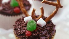 Little hands will enjoy transforming these easy-to-make chocolate-frosted cupcakes into mini-reindeer.