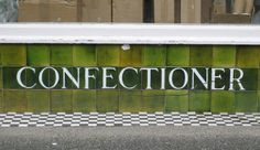 Original tiled typography on shop front in Falmouth