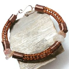Brown Viking Knit men's bracelet with antique copper spiral coils, and lodolite quartz beads.