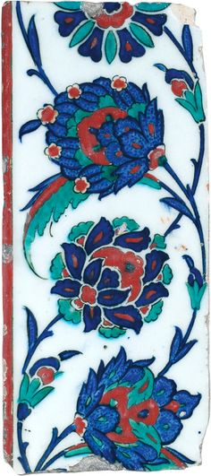 FLORAL SCROLLING BORDER TILE - Turkey (Iznik), circa 1575 - A finely painted polychrome under-glazed tile in colours of cobalt blue, emerald green and raised sealing wax red against a crisp white ground.