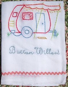 A sweet embroidered towel depicting the Button Willow vintage travel trailer.