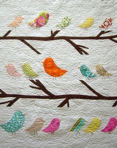Another Etsy winner - what a great graphic, colorful for kids, quilting is amazing.  Birds of a FeatherCrib/Toddler Size Quilt by TheBobbinsNest, $225.00