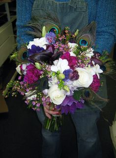 Peacock feathers and jewel tones in bridal boquet.