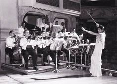 Valaida Snow conducting the orchestra on the set of the show Blackbirds at the Coliseum in London, October 5, 1934