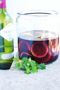 Sangria Recipe (1 bottle red wine, 1 cup fresh orange juice, ½ cup French brandy, ½ cup Grand Marnier, ¼ cup fresh lime juice, ¼ cup granular sugar, 2 cup club soda [optional])