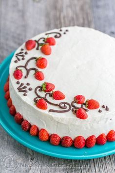 This strawberry cake is layer after delicious layer of fresh strawberries, a lightly sweet cream cheese frosting, and moist European sponge cake.