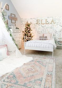I get a lot of questions about the wallpaper - I knew that I wanted to create a focal point wall behind her bed. Her room was already a light blue color, so I was looking for a floral print that had a soft color pallet. One night, I was researching patterns and came across Wallpaperie on Instagram. I went to their Etsy site and found the most beautiful and magical print called Whimsy Floral and instantly knew that was the one. This wallpaper is not only beautiful, but the quality was top notch. Diy Little Girls Room, Pastel Girls Room, Girl Decor, Big Girl Rooms, Decoration, Interior Design Living Room, Bedroom Decor, Bedroom Ideas, Floral Bedroom