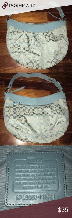 Coach Purse Baby blue coach purse. Lightly used. There is a small stain on the inside of the bag as shown in the last picture and a few more than are barely noticeable on the outside of the bag Coach Bags