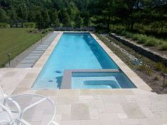 Lap pool with spa and automatic cover (www.oasisincorporated.com)