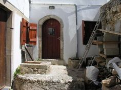 Traditional stone houses renovated in Limnes village