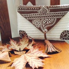 A personal favourite from my Etsy shop https://www.etsy.com/uk/listing/251074013/handmade-white-season-clucth-bag