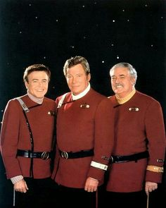 """United Federation of Planets Starfleet officers assigned to USS Enterprise {NCC-1701-A}, (L to R):  Commander Pavel Andreievich Chekov (Walter Marvin Koenig; born September 14, 1936), Captain James Tiberius Kirk (William """"Bill"""" Shatner, born March 22, 1931), Captain of Engineering Montgomery Christopher Jorgensen Scott (James Montgomery """"Jimmy"""" Doohan; March 3, 1920 – July 20, 2005)."""