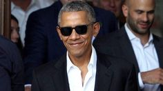 Civilian life looks💯 on Barry! After touching down in Milan, Italy, on Monday, former President Barack Obama looked cooler than a cucumber when he stepped out in sunglasses and awhite button-down...